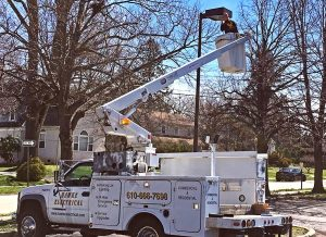 Bucket truck repairing parking light